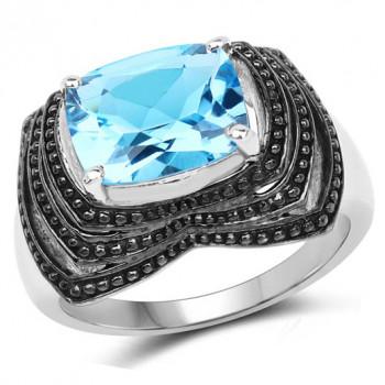 Inel impunator din argint si topaz albastru